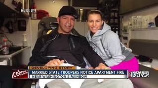 Off-duty married troopers help residents escape fire - Video