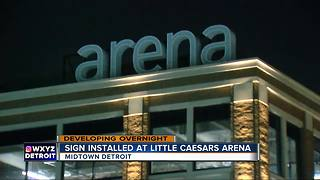 Sign installation begins on the outside of Little Caesars Arena - Video