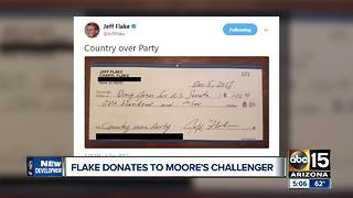 Arizona Senator Jeff Flake sends check in support to Roy Moore's opponent - Video