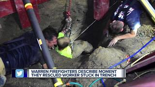 Warren firefighters describe moment they rescued worker stuck in trench - Video