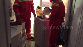 Boy, 10, rescued from washing machine - Video