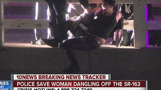 Police save woman dangling off Highway 163 overpass - Video