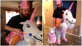 Father and daughter dress up as unicorns for Halloween