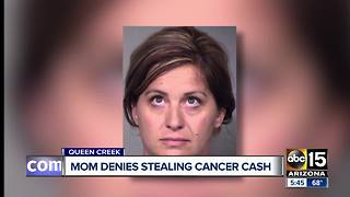 Mother denies stealing from family with cancer