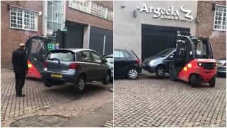 Forklift tows car in a very strange way