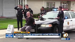Woman battles attempted home intruder - Video