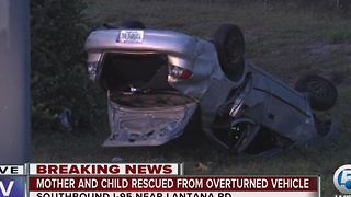 Mother, child rescued from overturned vehicle on I-95 in Lantana - Video