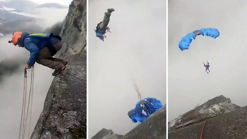 Long way down! Adrenaline junkie makes stomachs churn with back-flip off cliff