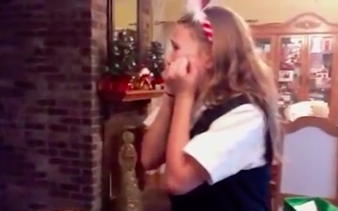 These people are overwhelmingly excited when they get puppies as surprise gifts