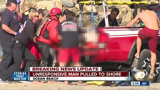 Unresponsive man pulled from water at Ocean Beach, rushed to hospital