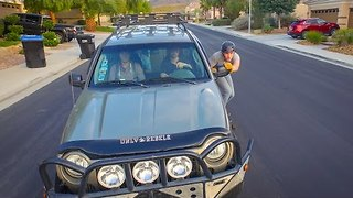 Longboarder Propels Himself Against Truck, Speeds Down Hill - Video