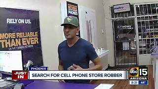 Man pulls gun on employee during north Phoenix cell phone store robbery - Video
