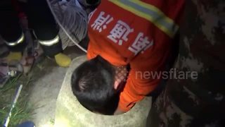 Firefighters rescue woman trapped in well - Video