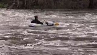 Man in Inflatable Raft Floats Down Rain-Swollen Yarra River - Video