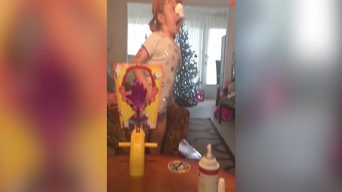 Young Girl Plays Pie Face Game With Her Dad