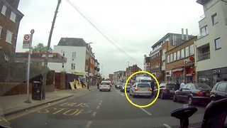 Careless motorist casually crosses lanes and holds up rush hour traffic to pop in a shop - Video