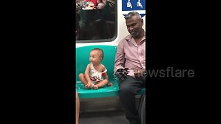 Heartwarming moment man and little girl watch 'Tom & Jerry' on train in Singapore