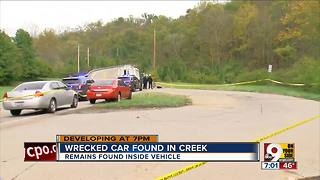 Wrecked car found in creek - Video