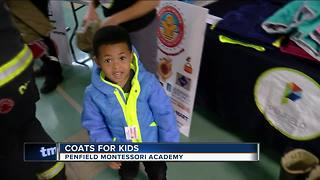 Milwaukee Fire Department donates free winter coats to local students - Video