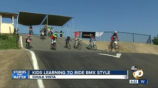 Kids learning to ride BMX-style