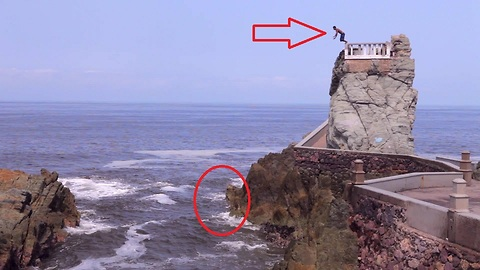 Fearless daredevil performs insane cliff jump