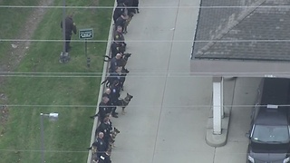 Police officers line up as they bring out WSU Police Officer Collin Rose