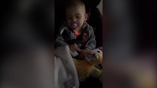 A Baby Girl Alternates Between Two Pacifiers