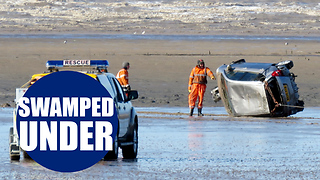 Family-of-five rescued after parking on a beach - Video