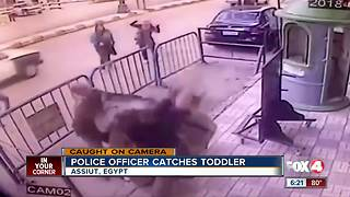 Police Officer Catches Toddler - Video