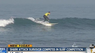 Shark attack survivor competes in surfing competition - Video