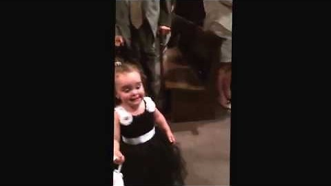 Precious Flower Girl Sees Dad While Going Down The Isle, Stops To Say Hi