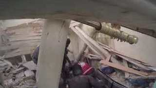 Child Pulled From Rubble by Rescue Workers in Douma