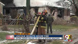 Firefighters battle Lincoln Heights house fire in snowy conditions - Video