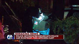 Police: Intoxicated driver hits police car in Detroit, officers injured - Video