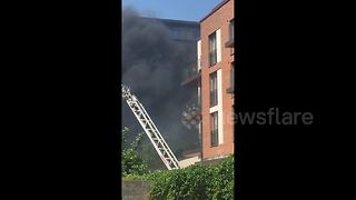Firefighters enter West Hampstead block of flats to fight blaze - Video