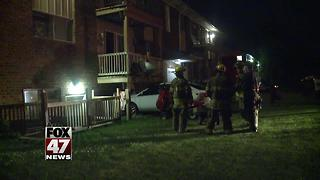 Car crashes into Lansing apartment - Video
