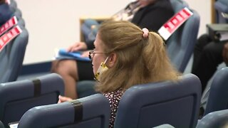 Woman removed from Palm Beach County meeting for not wearing mask