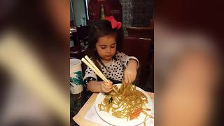 Tot Girl Struggles To Eat Noodles With Chopsticks