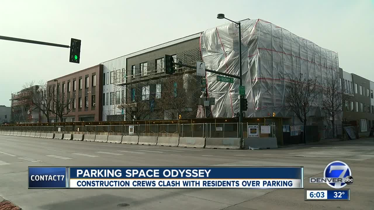 Residents complain that construction crews are taking over neighborhood and saving parking spots