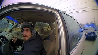 Body cam: Man drags officer after confrontation during traffic stop - Video