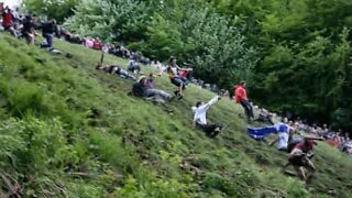 People throw themselves down a hill for... cheese!