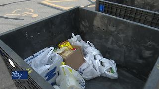 Boy Scouts help collect food for local charities - Video