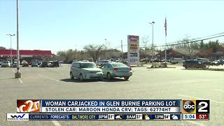 Carjacking suspect wanted after woman pushed out of car - Video