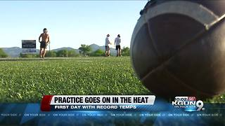 Intense heat doesn't stop high school football practice - Video