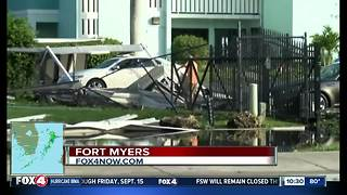 Carports destroyed and street flooding in downtown Fort Myers after Hurricane Irma - Video