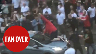 Football fan climbs on board MOVING car to celebrate England's world cup win - Video