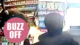 Hero shopkeeper swats away armed robber with wasp spray - Video