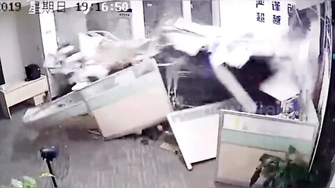 Chinese woman accidentally slams car into office injuring two people