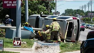Two car accident flips SUV on side, driver hospitalized - Video