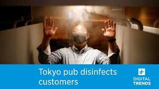 A Japanese restaurant is using a machine to sanitize customers.